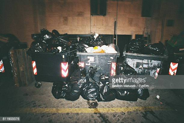 Garbage in alley at night