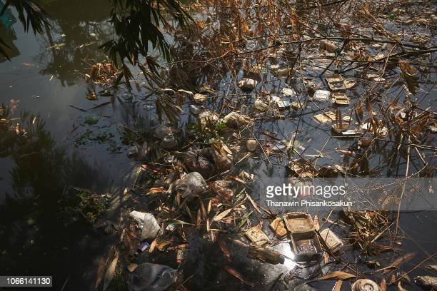 garbage in bangkok. - climate stock pictures, royalty-free photos & images