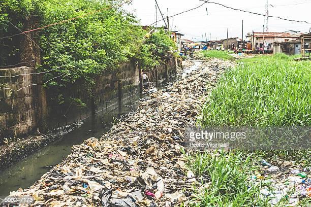 garbage in slum streets of lagos, nigeria. - lagos nigeria stock pictures, royalty-free photos & images