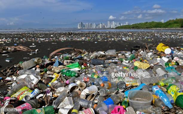 Garbage, including plastic waste, is seen at the beach of Costa del Este, in Panama City, on April 19, 2021. - Every two weeks, Marine Biology...