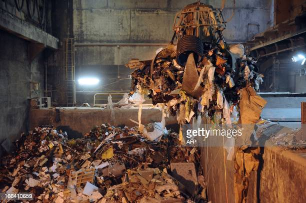 Garbage is carried to be incinerated at the Energy Recovery Unit of the garbage incineration plant in Le Mans western France on April 11 2013 The...