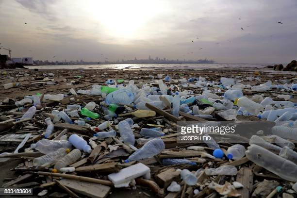 Garbage lie at Dbayeh's seaside shore north of Beirut on November 28 2017 after it was washed away by the sea from the nearby seaside garbage dump of...