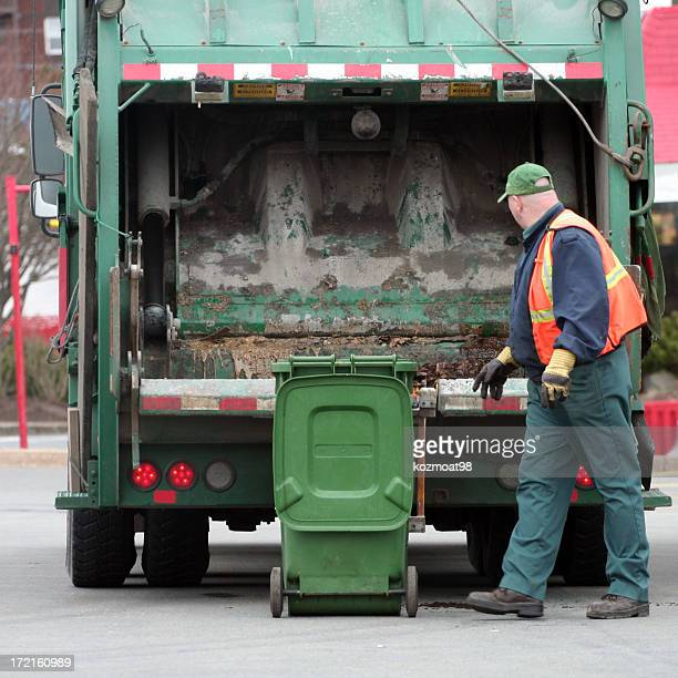 a garbage man dumping a bin into the garbage truck - garbage truck stock pictures, royalty-free photos & images