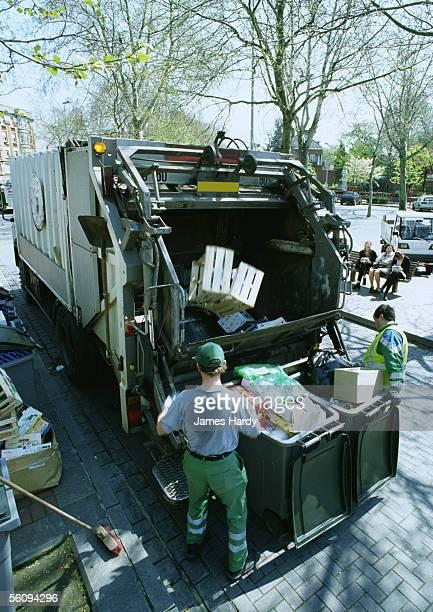 Garbage men picking up trash.