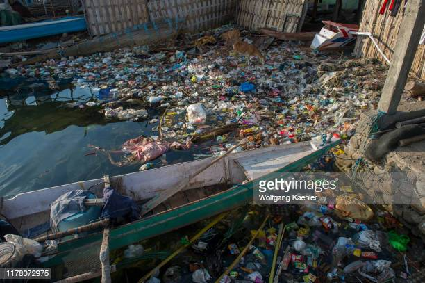 Garbage, mostly plastic, floating on the water at the Bajau Sea Gypsy village on Bungin Island, famous for living in stilt houses above the water and...