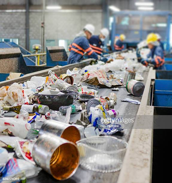 garbage on a conveyor belt for recycling - 廃棄物処理 ストックフォトと画像