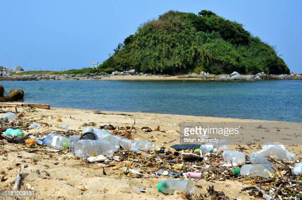 garbage on beach - environmental damage stock pictures, royalty-free photos & images