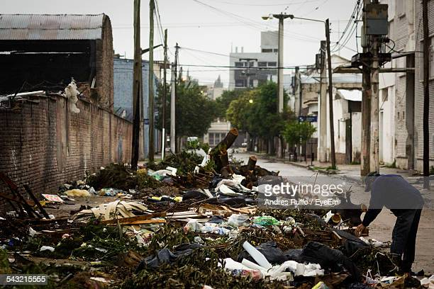 garbage on street in city - andres ruffo stock pictures, royalty-free photos & images