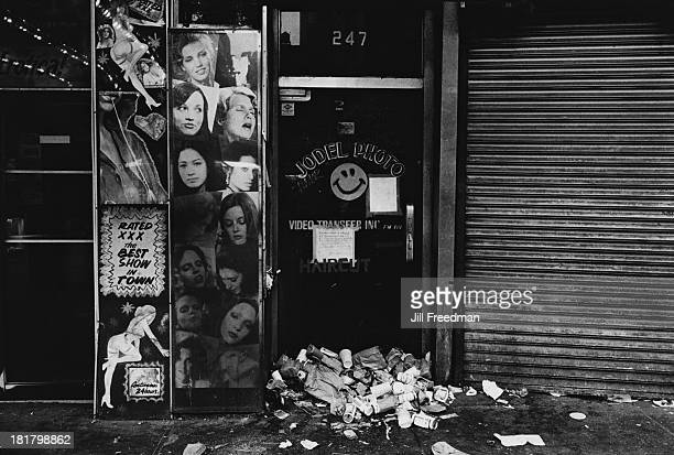 Garbage outside a peep show in Midtown Manhattan New York City 1982