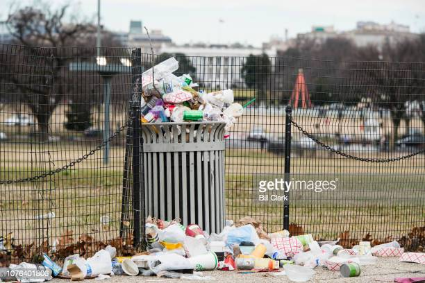 Garbage overflows a trash can on the National Mall across from the White House on Tuesday Jan 1 2019 The National Park Service which is responsible...