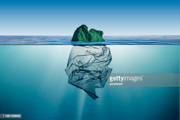 garbage plastic with island floating in the ocean - environment stock pictures, royalty-free photos & images