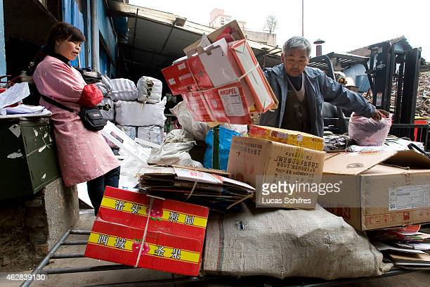 A garbage recycler brings trashed materials to a recycling center on April 8 2010 in Shanghai China This longtime garbage recycler didn't want to...