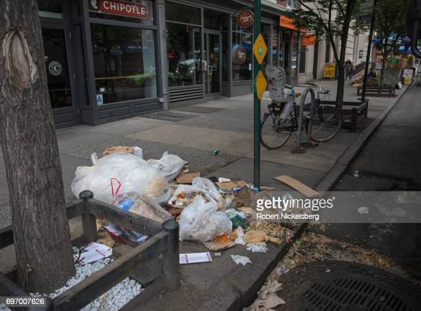 Garbage ripped open by rats sits in front of Chipotle's restaurant on Court Street June 16 2017 in Brooklyn New York Numerous complaints about rat...