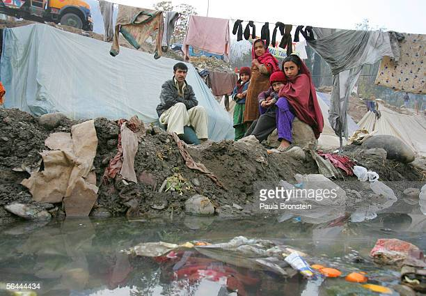 Garbage sits in a polluted stream where earthquake survivors dump their rubbish at a dirty tented camp December 16 2005 in Muzaffarabad Pakistan The...