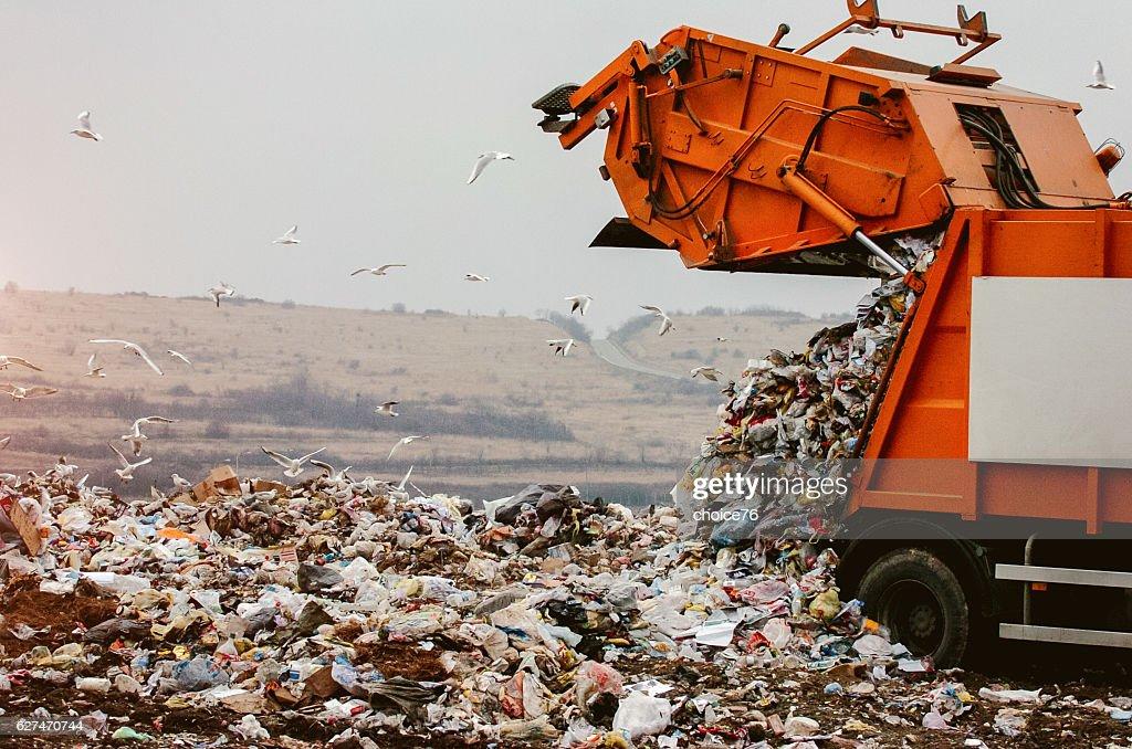 Garbage truck dumping the garbage : Stock Photo