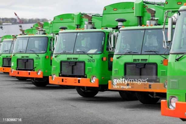 garbage truck fleet - garbage truck stock pictures, royalty-free photos & images