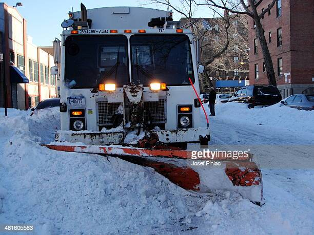 CONTENT] A garbage truck outfitted with a snow plow for snow clearing duty Taken in Long island City during the blizzard in 2010 in New York City