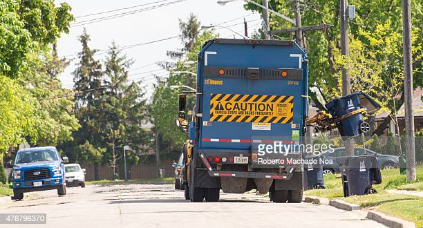 Garbage truck removing house garbage from the streets inhabitants place containers outside at certain dates and trucks picks the trash from curb