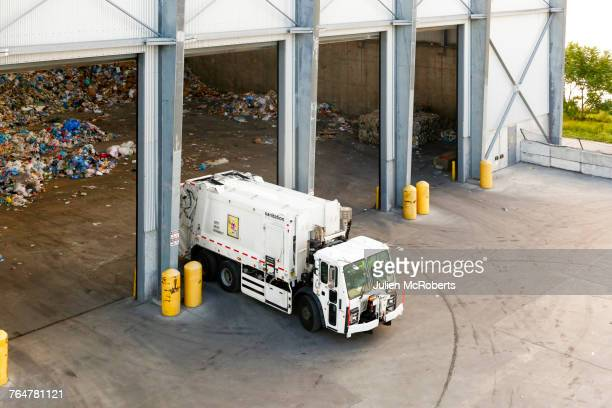 garbage truck unloading trash - garbage truck stock pictures, royalty-free photos & images