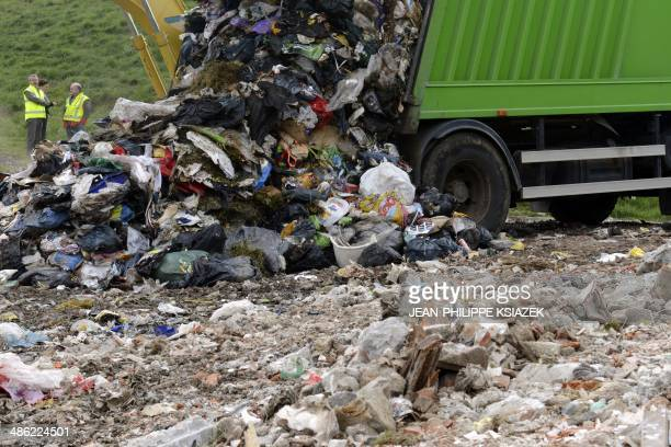 A garbage truck unloads collected trash at the Technical Landfill Centre of Villemarche that handles the disposal of organic waste dumped at site in...