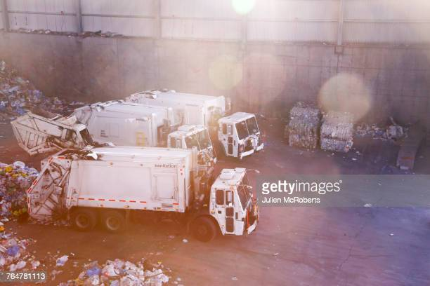 garbage trucks unloading trash - garbage truck stock pictures, royalty-free photos & images