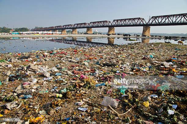 Garbagedeposit on the banks of the river Yamuna In the background the Taj Mahal