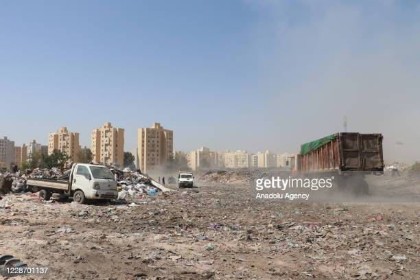 Garbages are transferred to a dump site by garbage trucks in Tripoli, Libya on September 10, 2020. Garbages collected in Tripoli are transferred to...
