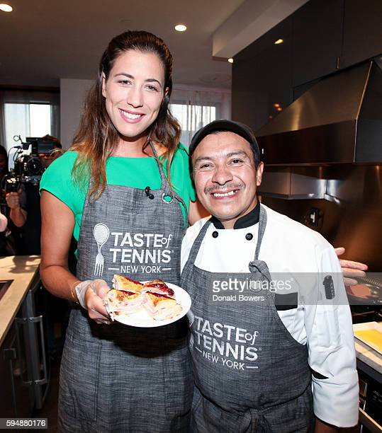 Garbiñe Muguruza and Chef Arturo Vivanco cook together during The Taste Of Tennis Master Class With St Giles Hotels at The Tuscany A St Giles...