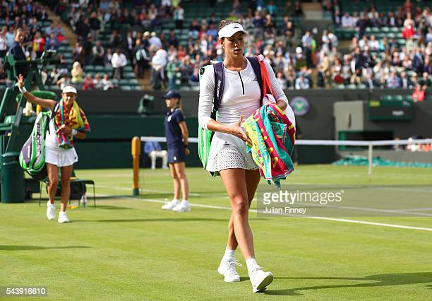 Garbine Mugaruza of Spain looks on following defeat during the Ladies Singles second round match against Jana Cepelova of Slovakia on day four of the...