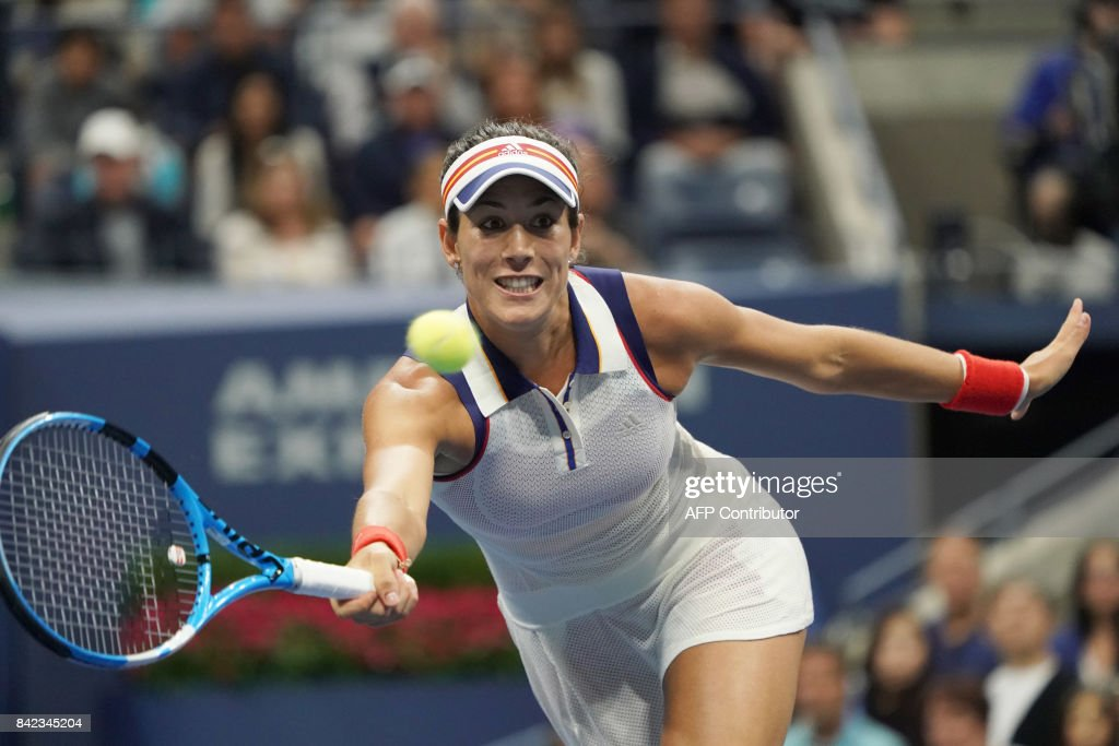TOPSHOT - Garbine Mugurusa of Spain hits a return to Petra Kvitova of the Czech Republic during their 2017 US Open Women's Singles match at the USTA Billie Jean King National Tennis Center in New York on September 3, 2017. Two-time Wimbledon champion Petra Kvitova advanced to the US Open quarter-finals by eliminating Spanish third seed and reigning Wimbledon champion Garbine Muguruza 7-6 (7/3), 6-3. /