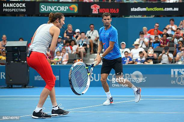 Garbine Muguruza and Grigor Dimitrov of Germany take part in the Pat Rafter Arena Spectacular during day one of the 2017 Brisbane International at...