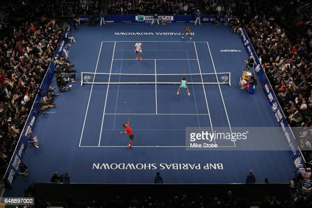Garbine Muguruza and Kei Nishikori of Team World play during their Mixed Doubles match against Venus WIlliams and Juan Martin del Potro of Team...