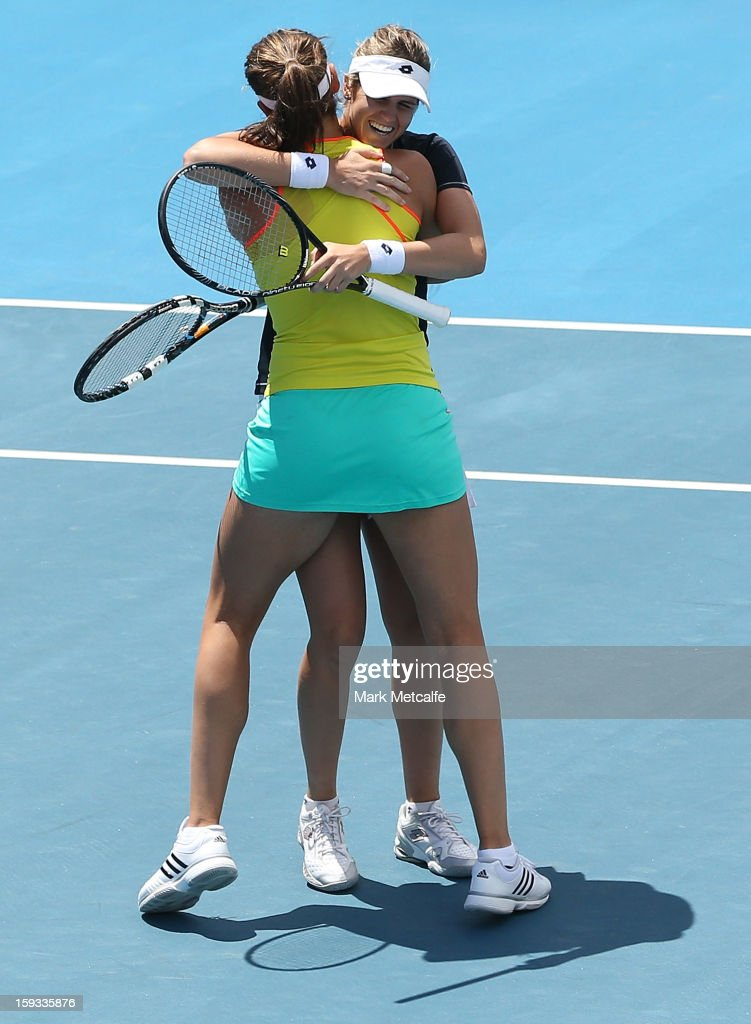 Garbine Muguruza and Maria-Teresa Torro-Flor of Spain celebrate after winning match point in their doubles final match against Timea Babos of Hungary and Mandy Minella of Luxembourg during day nine of the Hobart International at Domain Tennis Centre on January 12, 2013 in Hobart, Australia.