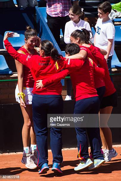 Garbine Muguruza Captain Conchita Martinez Carla Suarez Navarro and Sara Sorribes of Spain celebrate after defeating Italy during day two of the Fed...