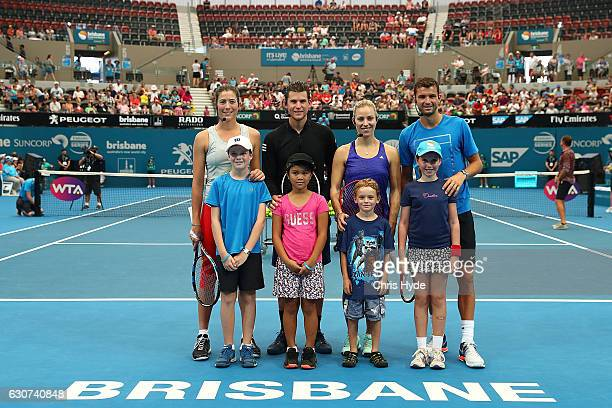 Garbine Muguruza Dominic Thiem Angelique Kerber and Grigor Dimitrov pose for photos with children during the Pat Rafter Arena Spectacular during day...