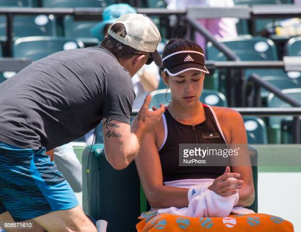 Garbine Muguruza from Spain listens to her coach during a change over in her match against Sloane Sephens from the USA at the Miami Open in Key...