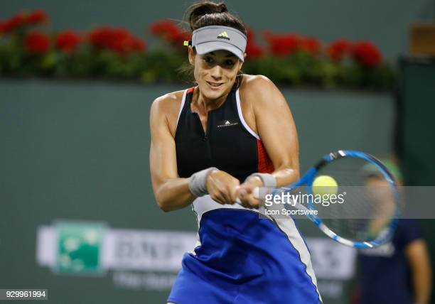 Garbine Muguruza hits a backhand during the second round of the BNP Paribas Open on March 09 at the Indian Wells Tennis Gardens in Indian Wells CA