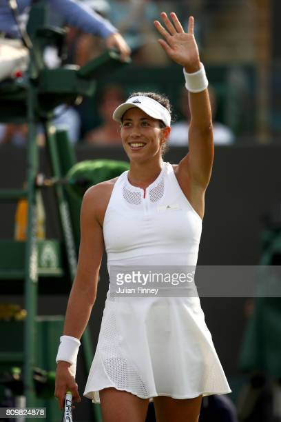 Garbine Muguruza of Spain acknowledges the crowd as she celebrates victory after her Ladies Singles second round match against Yanina Wickmayer of...