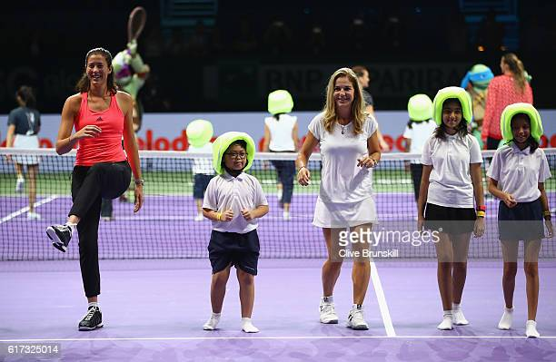 Garbine Muguruza of Spain and Arantxa Sanchez Vicario of Spain take part in Family Day during day 1 of the BNP Paribas WTA Finals Singapore at...