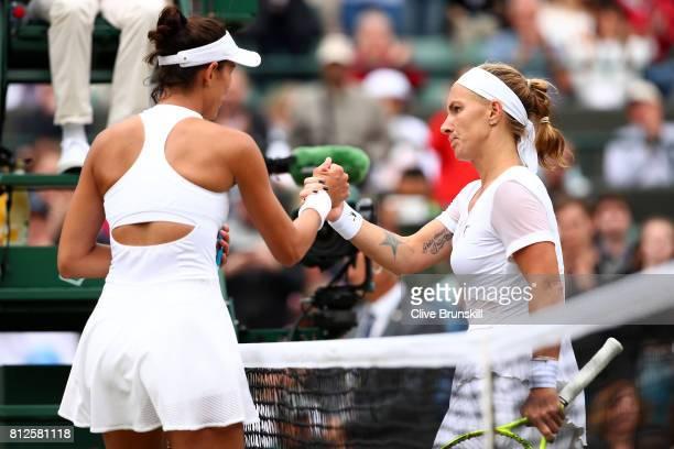 Garbine Muguruza of Spain and Svetlana Kuznetsova of Russia shake hands after the Ladies Singles quarter final match on day eight of the Wimbledon...