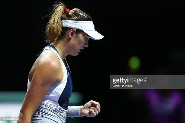 Garbine Muguruza of Spain celebrates a point during her semi-final match against Agnieszka Radwanska of Poland during BNP Paribas WTA Finals at...