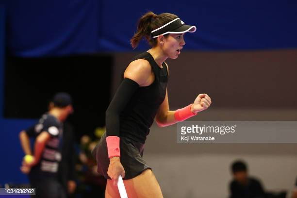 Garbine Muguruza of Spain celebrates a point during her singles first round match against Belinda Bencic of Switzerland on day one of the Toray Pan...