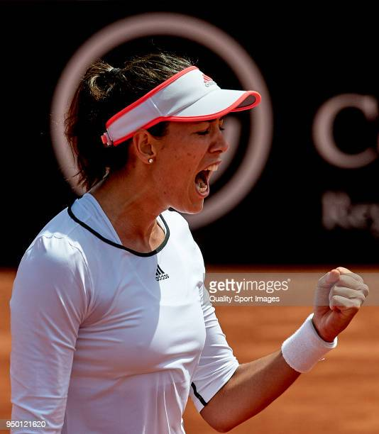 Garbine Muguruza of Spain celebrates a point during the match against Veronica Cepede of Paraguay during day two of the Fed Cup by BNP Paribas World...