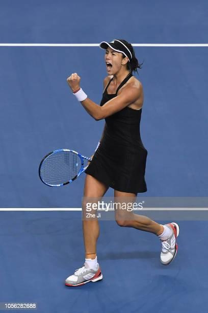 Garbine Muguruza of Spain celebrates after defeating Anastasija Sevastova of Latvia during their women's singles match on day 4 of the 2018 WTA Elite...