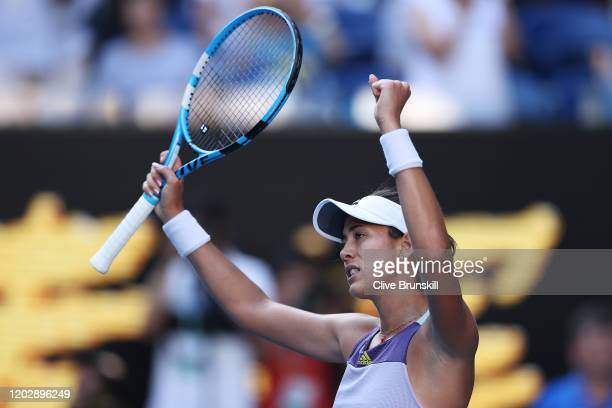 Garbine Muguruza of Spain celebrates after winning her Women's Singles Semifinal match against Simona Halep of Romania on day eleven of the 2020...