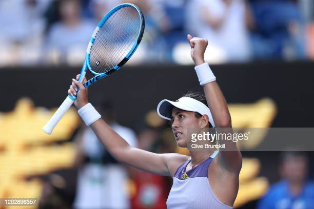 Garbine Muguruza of Spain celebrates after winning match point in her Women's Singles Semifinal match against Simona Halep of Romania on day eleven...