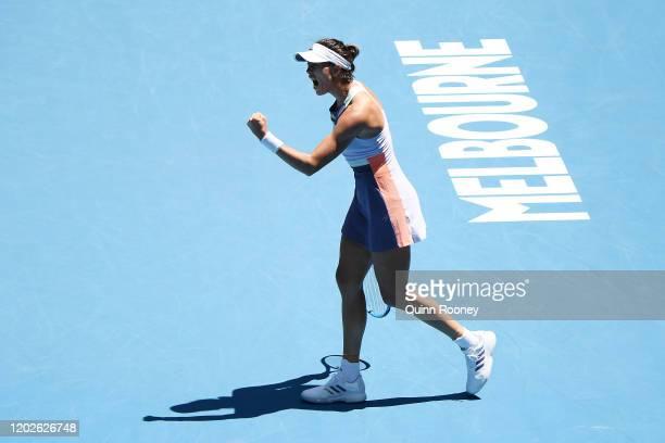 Garbine Muguruza of Spain celebrates after winning the first set during her Women's Singles Quarterfinal match against Anastasia Pavlyuchenkova of...