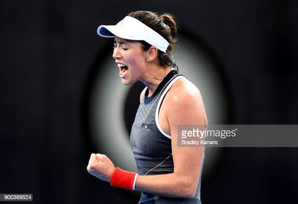 Garbine Muguruza of Spain celebrates after winning the first set in her match against Aleksandra Krunic of Serbia during day three of the 2018...