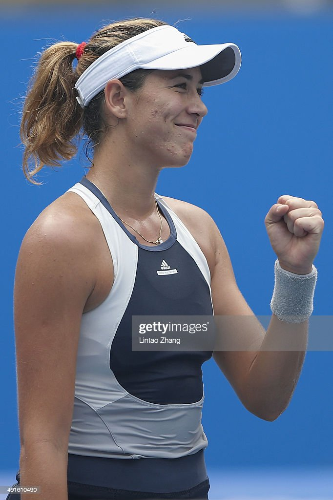 Garbine Muguruza of Spain celebrates after winning the match against Irina Falconi of the United States during the Women's singles Second round match on day five of the 2015 China Open at the China National Tennis Centre on October 6, 2015 in Beijing, China.