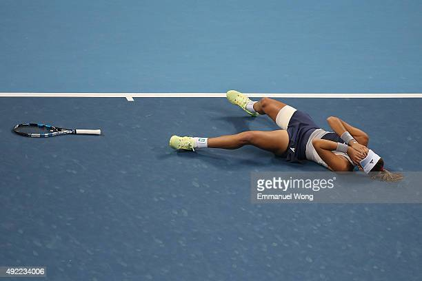 Garbine Muguruza of Spain celebrates after winning the Women's single final match against Timea Bacsinszky of Switzerland during on day 9 of the 2015...